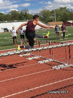 Look at that form! Eighth grader Austin Kravets competed in the hurdle events in the meet. Kravets cometed in the boys 110 meter hurdles.