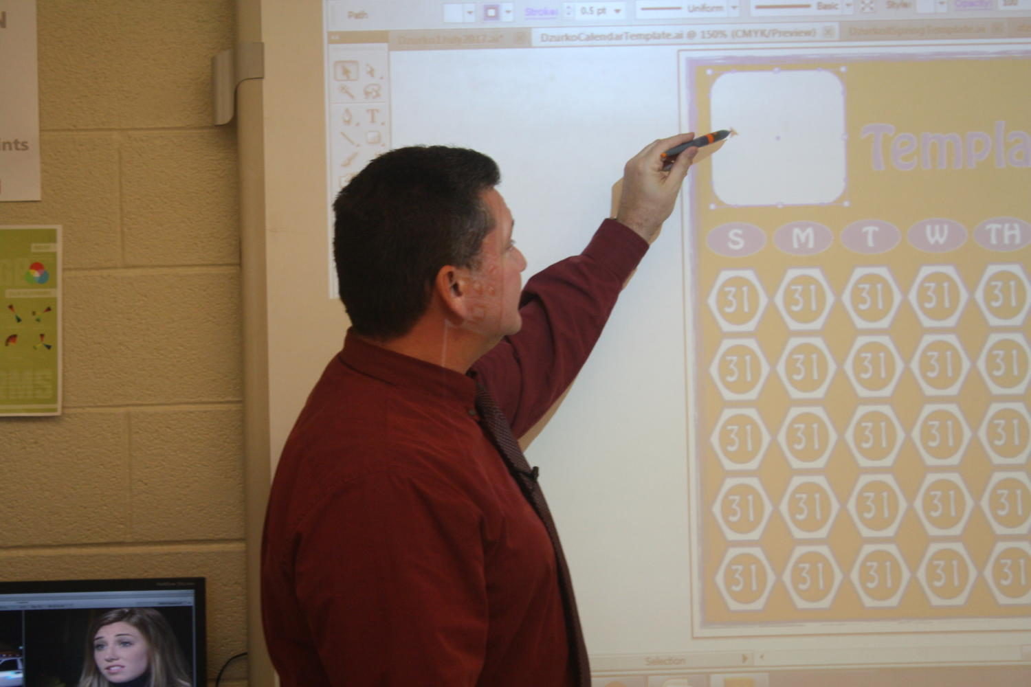 Tim Dzurko instructs his class from the smartboard.