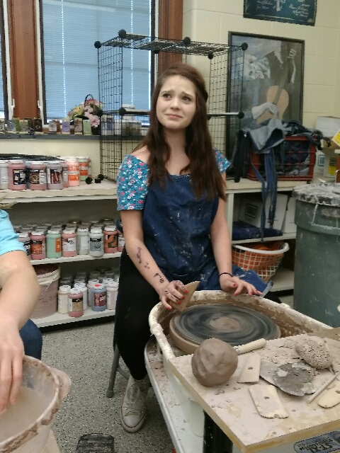 Wow%21+Reporter+Lily+Miller+tries+pottery+for+the+first+time+by+watching+Jessica+Helsel+make+a+bowl.++The+look+on+her+face+pretty+much+shows+how+some+students+feel+when+facing+the+wheel+for+the+first+time.++