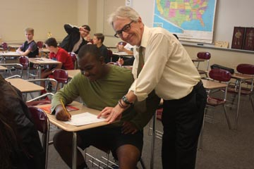Teacher Don Church works with Javionne Davis during one of the last few days of the school year and his teaching career.