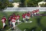 The seventh grade maroon football team warms up by doing a few laps on September 3rd, 2017. After they did a few laps all of the maroon football players got into lines and started stretching out.
