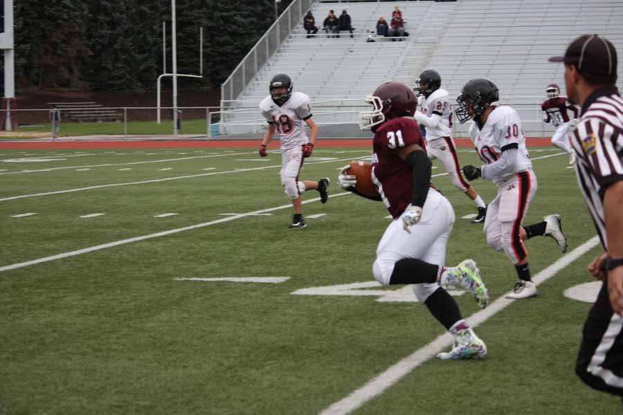 Adam Zerbee runs in for a 63 yard touchdown, avoiding all of the opposing defenders. Adam scored 2 touchdowns that game.