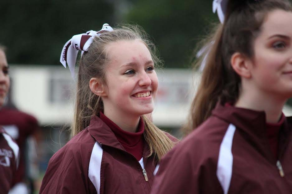AAJHS+cheerleader+Holly+Imler+smiles+to+the+crowd+at+Mansion+Park+on+September+second.+Holly+cheered+for+her+team+with+a+winning+score+of+39-12.