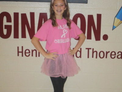 Laney Degennaro, ninth grader, shows her spirit during the pink out on thursday. The pink out helped raise awareness for breast cancer.