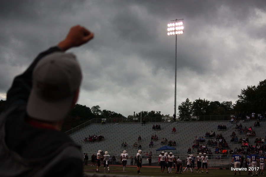Jack Hatch cheers on the ninth grade football team on Thursday, Oct. 12, against Central Catholic.