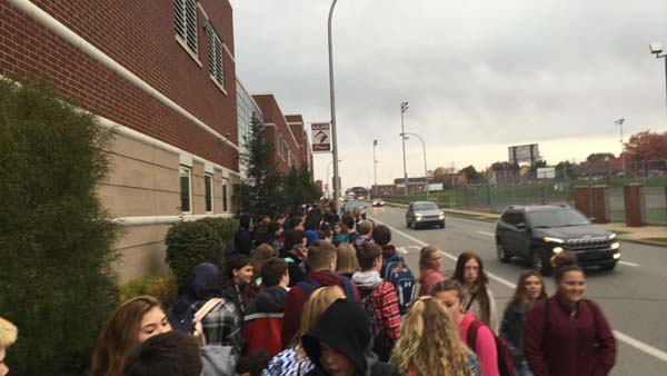 Students stand and wait outside to be checked by security at AAJHS on Tuesday, Nov. 7.