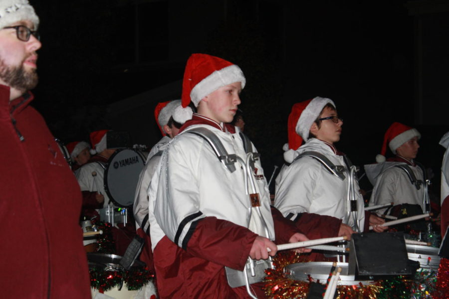 Ninth+grader%2C+Jamen+McCabe%2C+marches+down+the+street+at+the+Christmas+parade%2C+Nov.+30.+Mcabe+follows+along+with+his+fellow+band+members+and+marched+while+the+music+played.