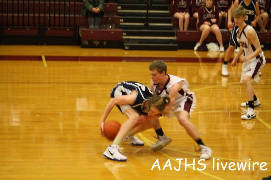Give It! Ninth grade basketball player, Kyle Pheasant tries to steal the ball from his Holidaysburg opponent. Pheasant was successful and was able to pass the ball to another AAJHS player.
