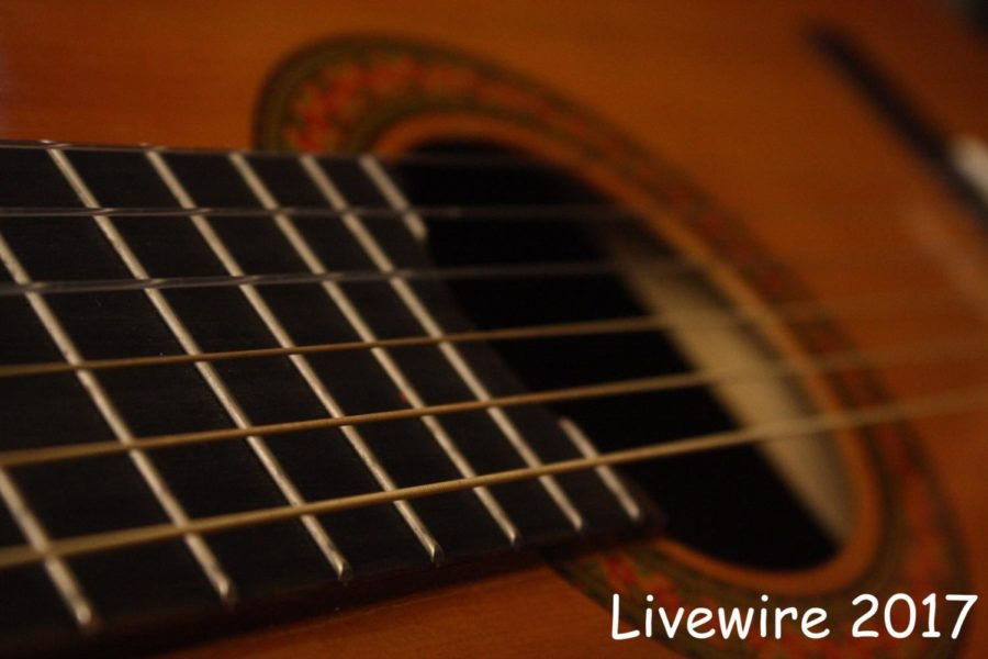 Only+one+guitar+is+left+after+Mr+Martin%27s+second+period+class+grabs+the+instruments.+The+class+started+to+learn+three+cords+G%2C+F+and+C+last+week.