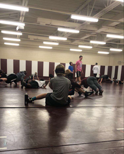 The wrestlers practicing after school to prepare  for future matches.