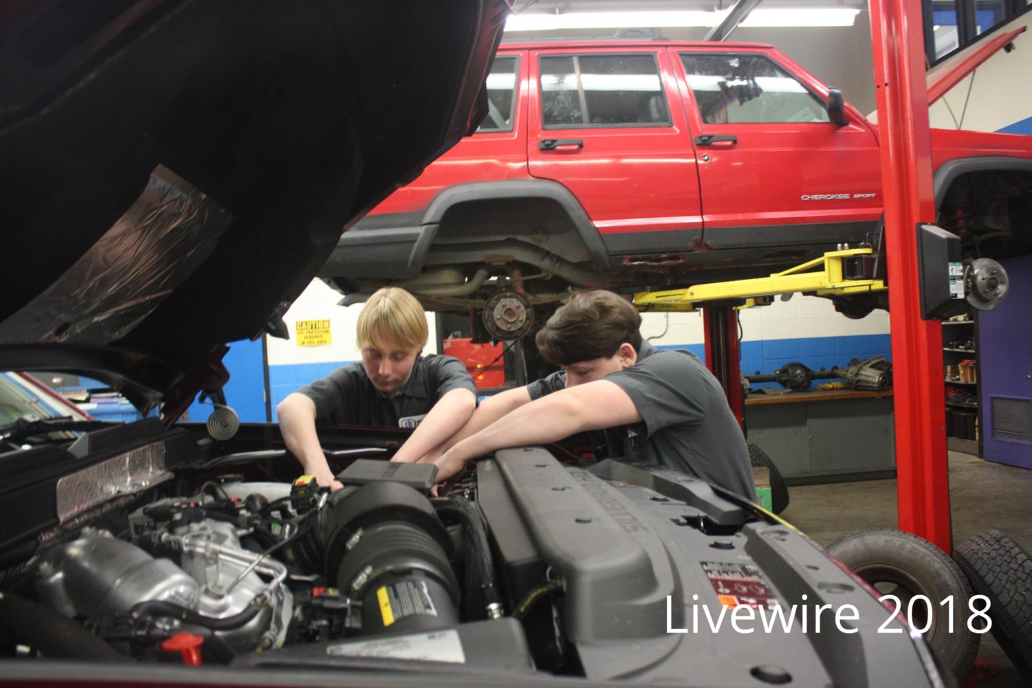 Let's work. Andrew Garman and david Harpster III work on a car in Automotive Diesel class at the CTC on Jan. 11. Both boys worked on their teachers car and learned how to change spark plugs on a truck.
