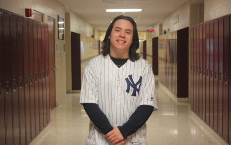 Ninth grader Cameron Passarello wore a New York Yankees baseball home jersey , supporting #99 Aaron Judge , the outfielder.