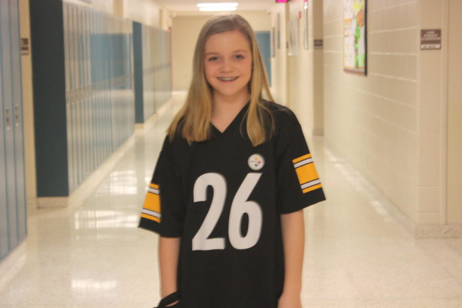 Seventh Grader Keira Mayhue supports  #26 from the Steelers ,  Le'veon Bell.