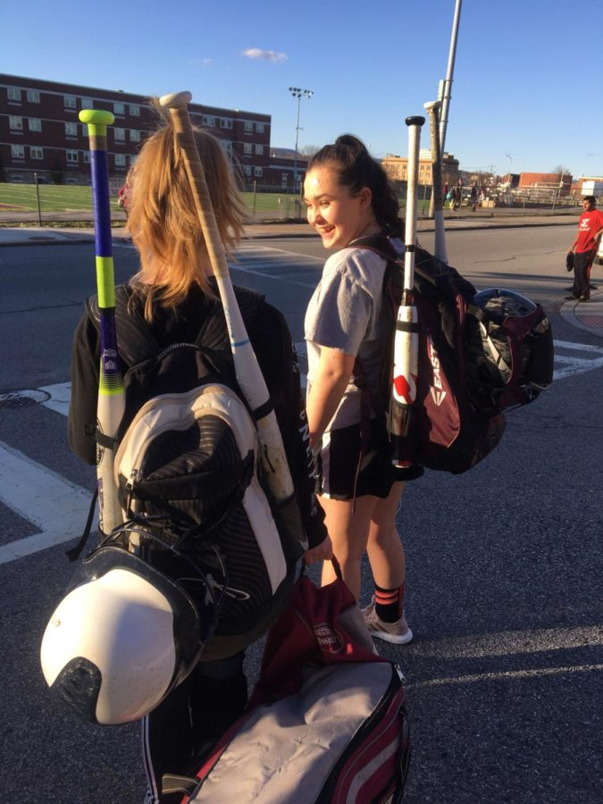 Eighth graders Rachel Dionis and Alana Cunningham get ready to go to a softball open gym.