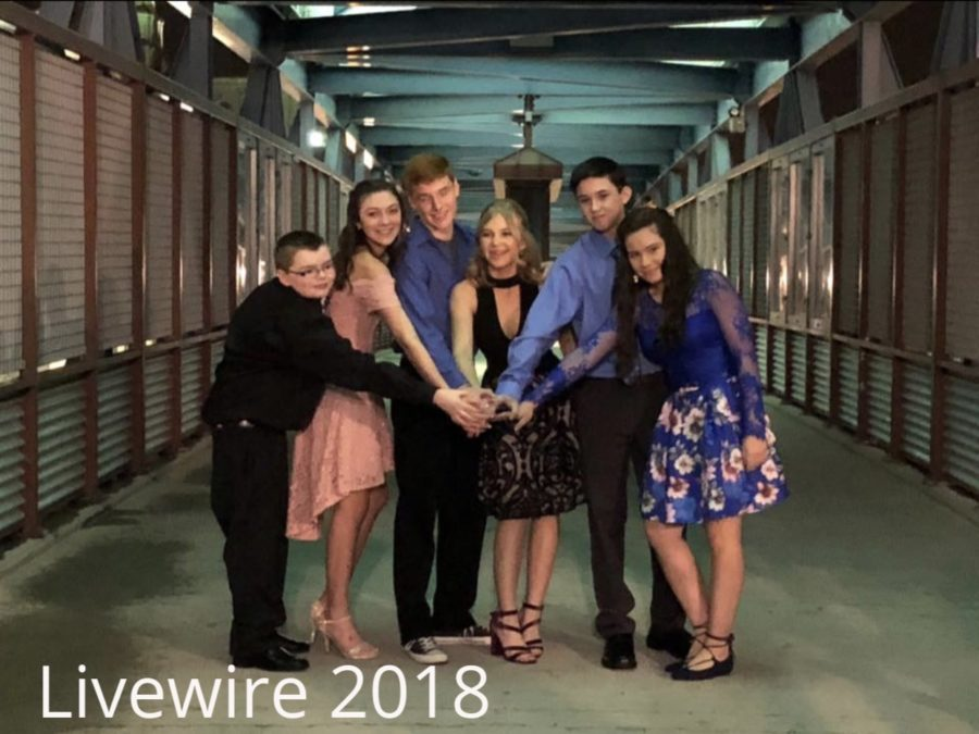 Love. A group of students got pictures at the Sweethearts dance on Feb. 15. The students held hands then got more pictures after.