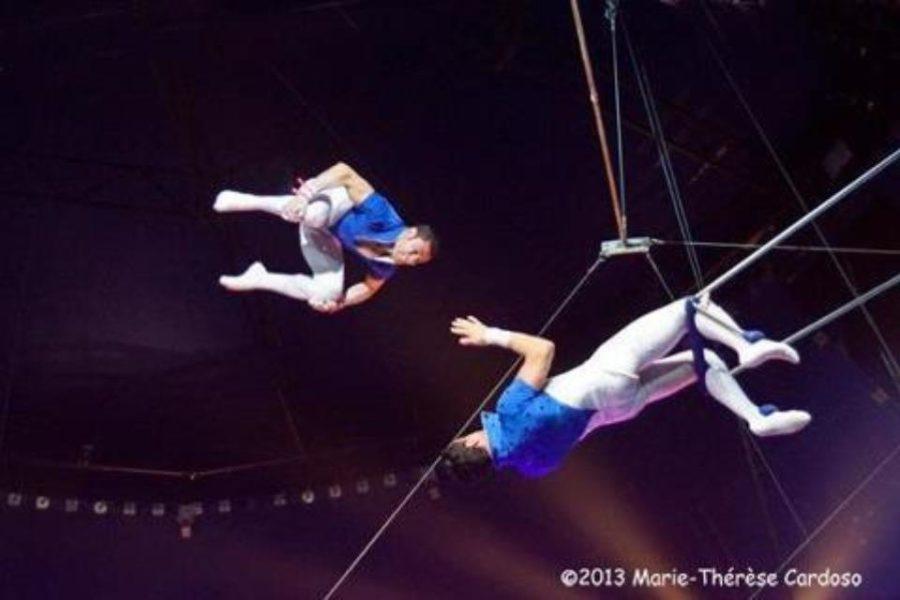 Alex Cortes performs a trapeze trick!