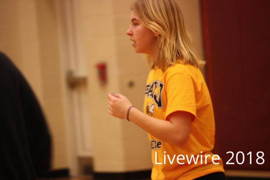 Whoosh. Julia Lane takes a breath after a hard game of dodgeball on Feb. 21. Lane played with her friends and won the game a few times.