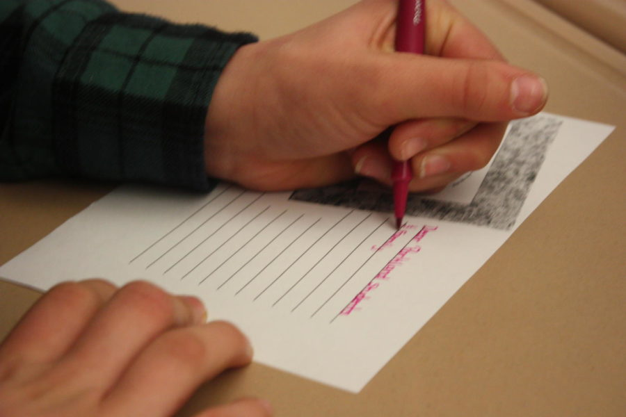 Students in Makenzie Wilt's eighth grade classroom write postcards to Parkland students after viewing the television segment created by AAHS students.