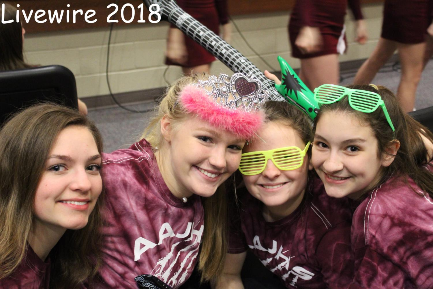 Isabella Frank, Alaina Koehle, Mya Crownover, and Eve Hogan are all showing their spirit by wearing maroon and white.