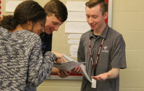 Connor Chywski, a new addition to the staff for the 2017-2018 school year, teaching two of his ninth grade English students, Eryka Moss and Nick Santone.