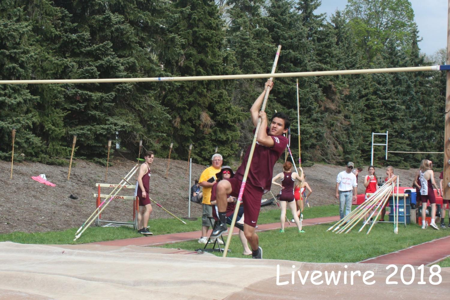 Jump! Jace Ebersol vaults on May ninth. Ebersol was part of the few ninth grade pole vaults.