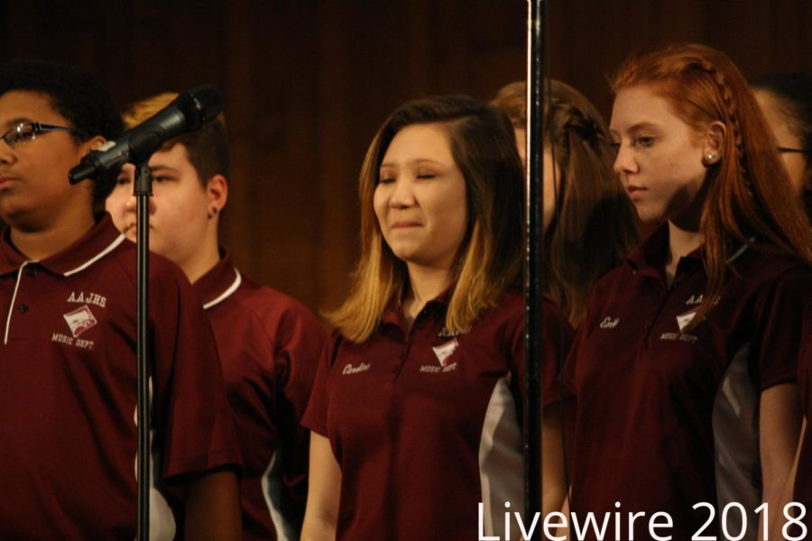 Haha. Peyton Shaffer and Emily McGuire smile at their spring concert on May 4. They smiled and continued singing.