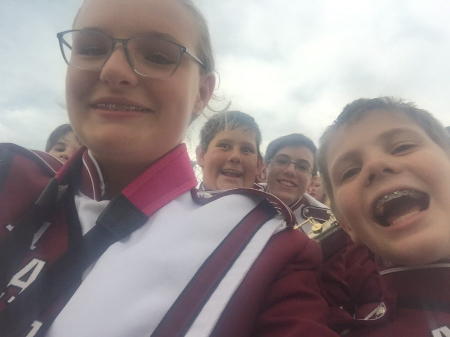 Let's go lions! Hailey Frontino and Matt Kennedy take a picture right before their marching band performance.