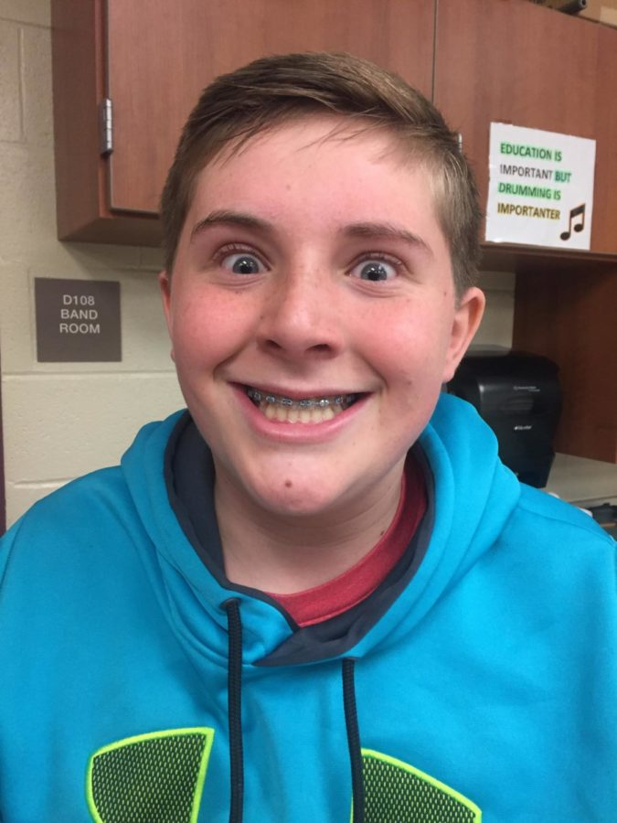 Smile! Brennen Dugan shows off his great smile while having fun in the band room.