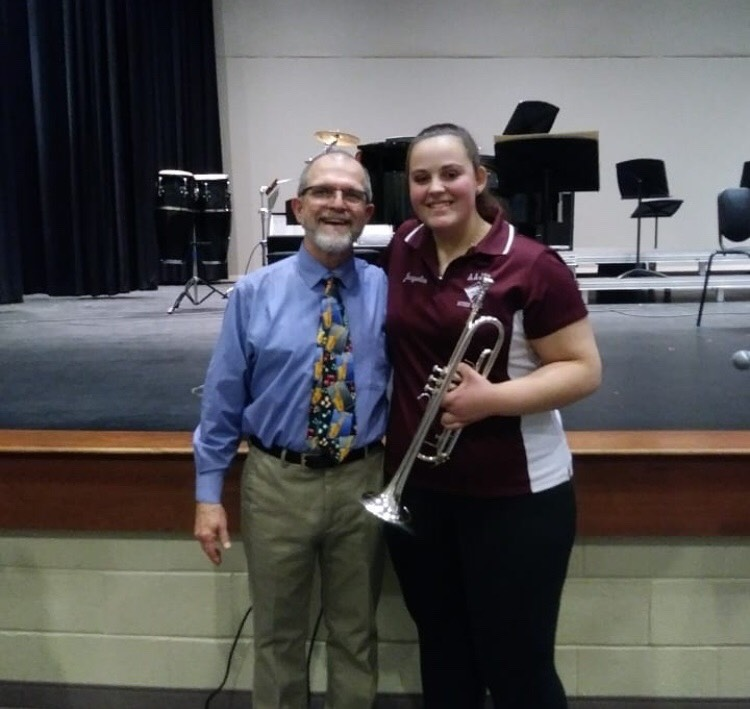 We will miss you! Mr. Yon and Jacqueline Ertwine say cheese as they cherish their last jazz band concert at AAJHS.
