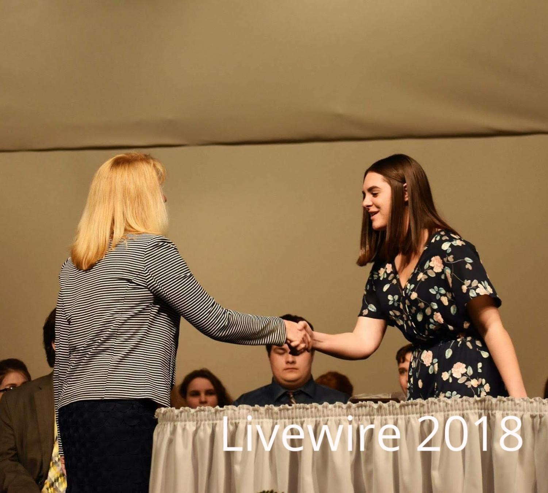 Thank you. Gionna Civarella shakes Lori Mangan's hand at the ninth grade awards ceremony on May 2. Civarella shook her hand and then sat back down.