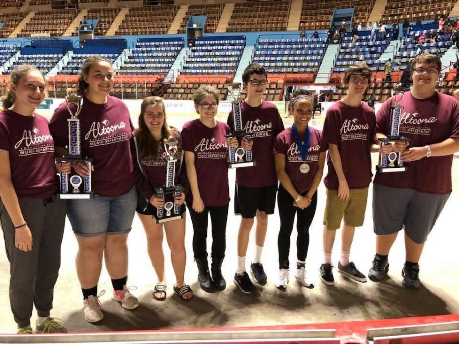 Take a bow!  The Altoona music department competed in Music in the Parks in Hershey.  Emily Latten, Jackie Ertwine, Rebecca Dieter, Emily DeFrancesco, Andrew Zupon, Ami Smith Banks, Seth Brunnhuber and Aiden Philips went up to receive the awards for the music department.