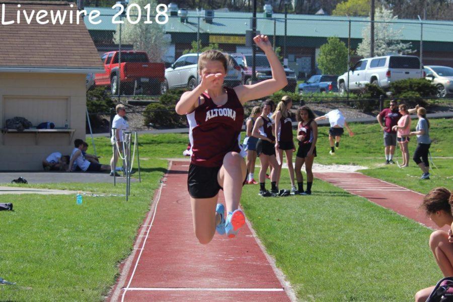 Up! Brooke Davis jumps up in long jump. Davis beet her last pr