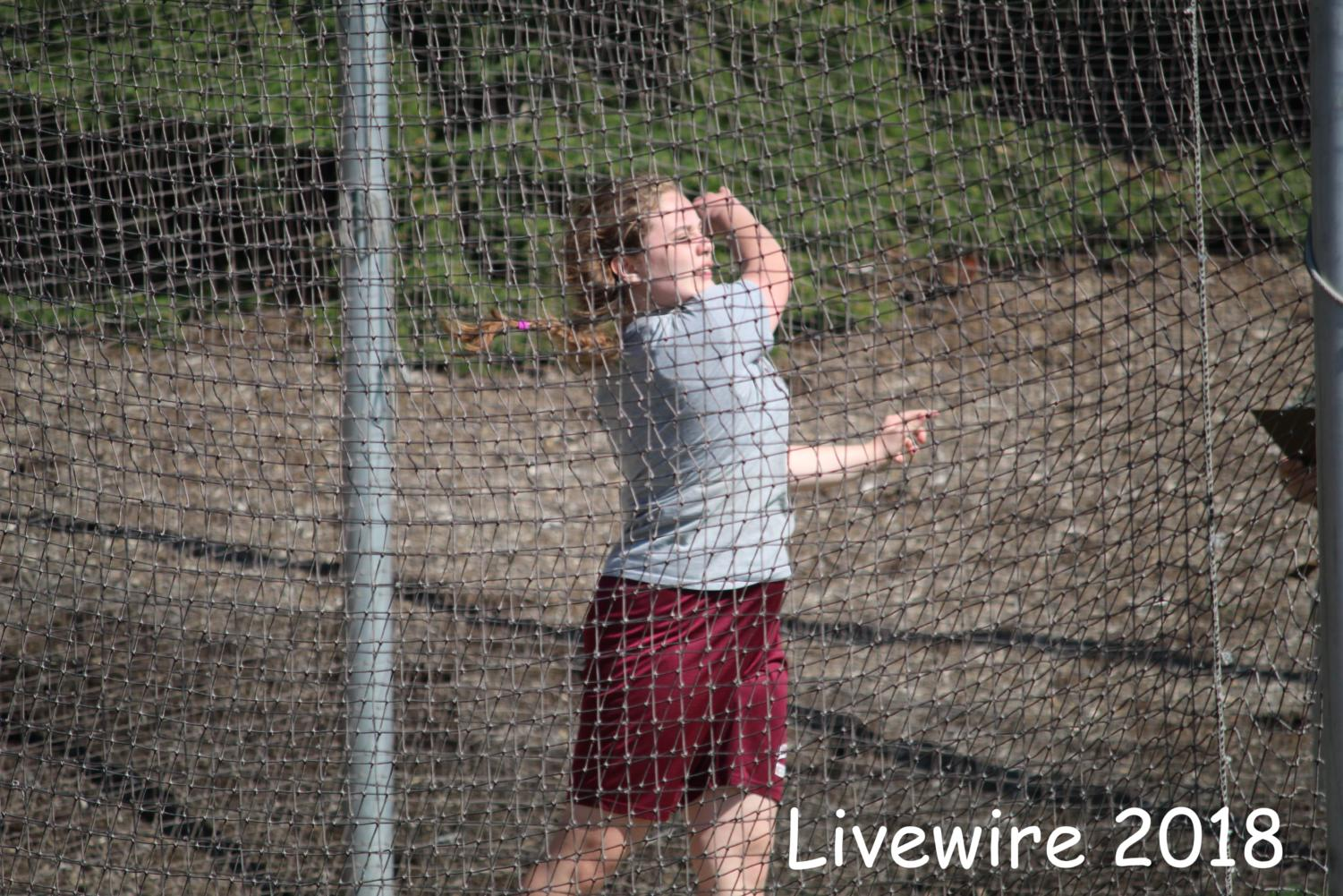 Push! Samantha Abbott throws the discus. Abbott also threw the shot put.