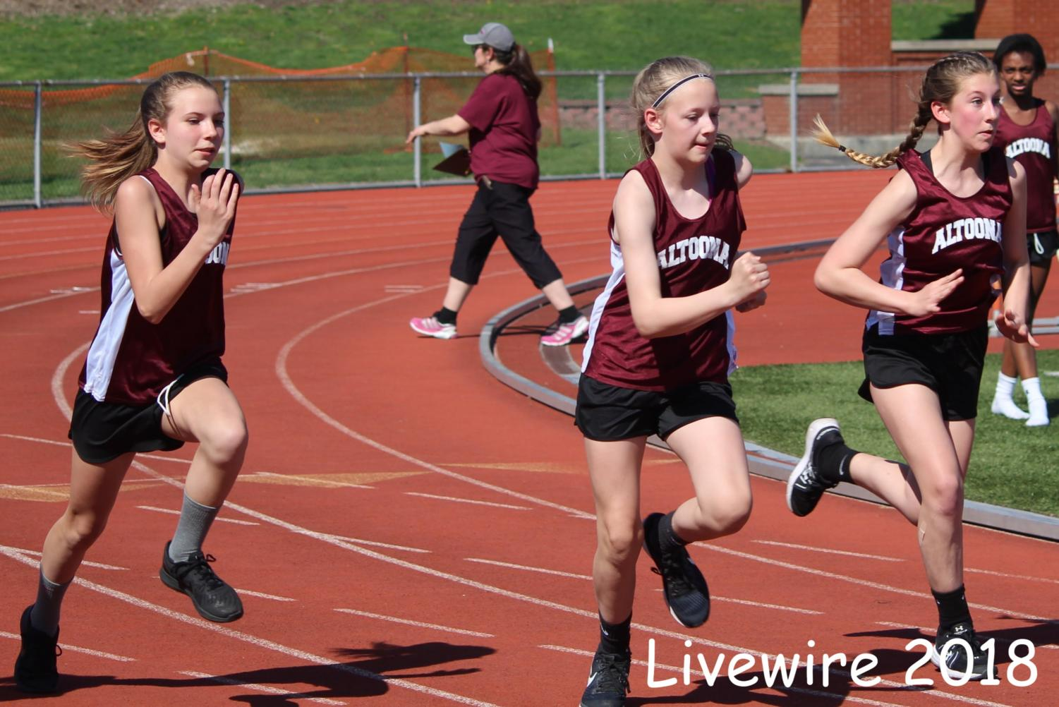 Ready%21+Three+more+sprinters+run+in+the+100+meter+dash.+Altoona+won+the+100.+