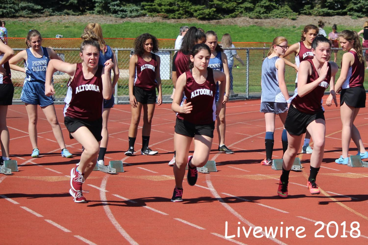 Set%21+Three+of+the+Altoona+sprinters+sprint+in+the+100+meter+dash.+The+sprinters+also+ran+in+the+4x1.+