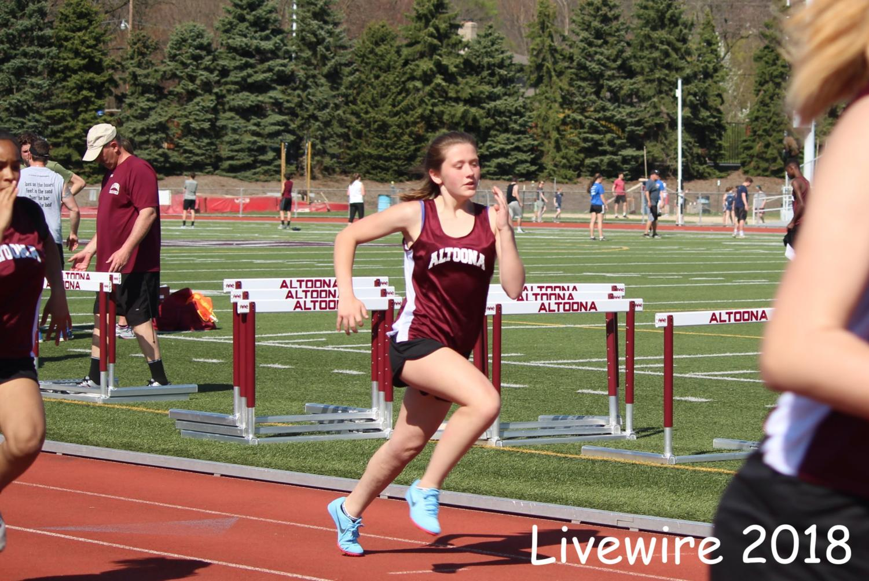 GO%21+Brooke+Davis+runs+in+the+100+meter.+Davis+also+long+jumped.+