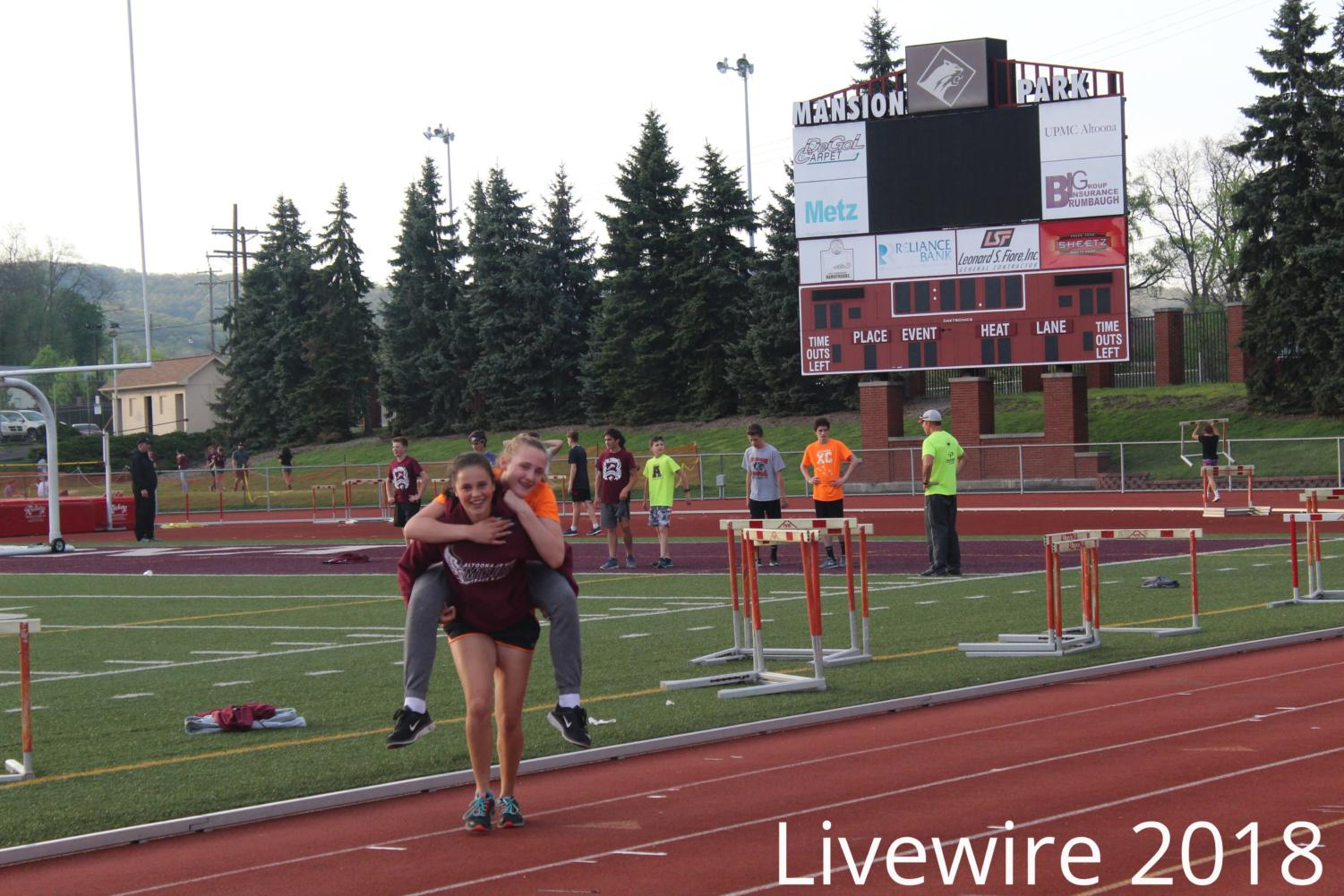 Let's go. Jadeyn Price and Nyah Perez run over to the camera at track practice on May 4. Price and Perez got the picture then practiced with the team.