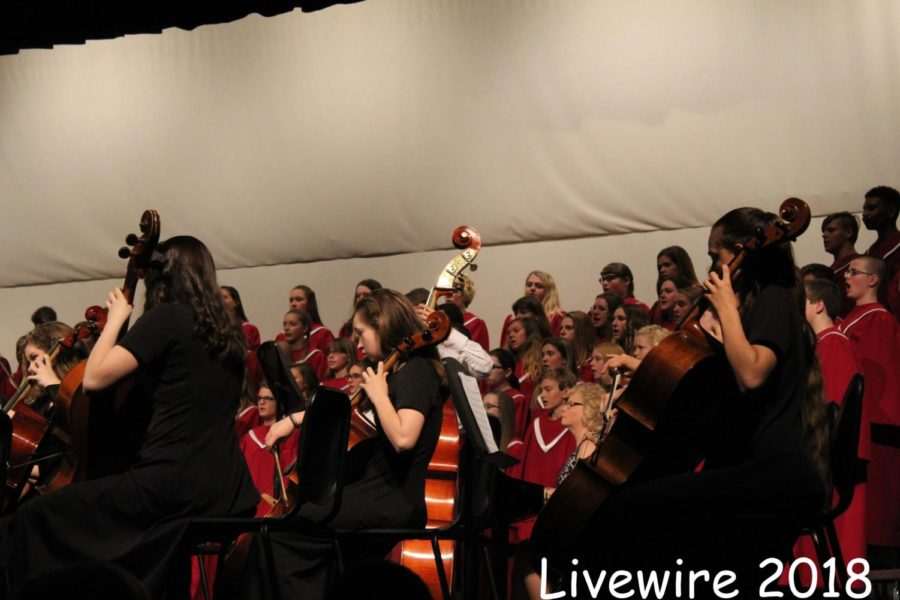 Play! The seventh grade orchestra and chorus sing and play the song,