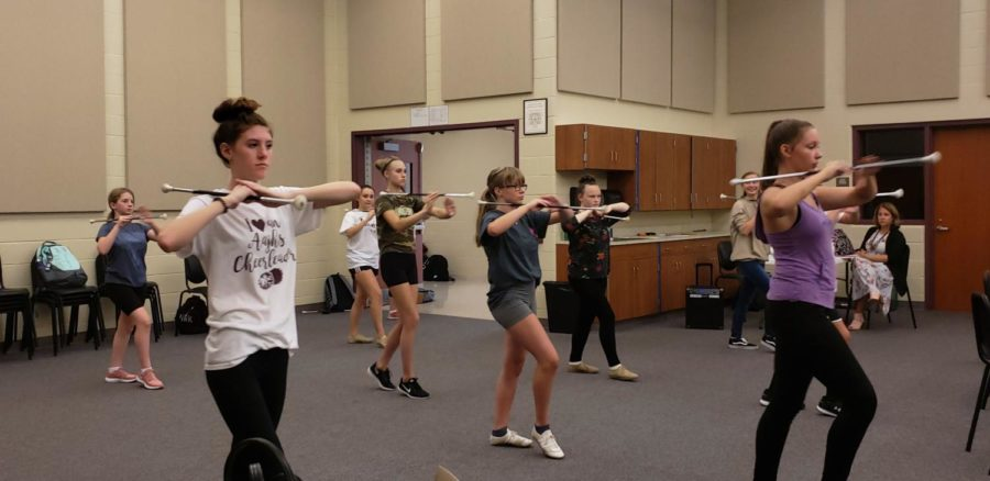 Tweet Tweet! The Majorettes hear the whistle, so they get into the beginning pose. They all have to be on time, and snappy to get to the pose.