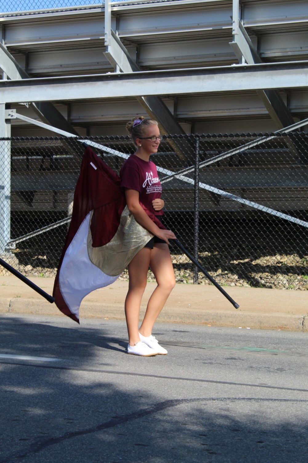 Waving Flags This is a picture of Piper Bastian marching in the AAJHS parade.