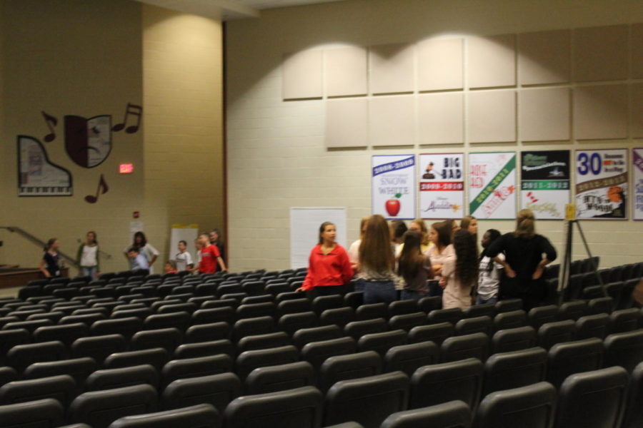 Gather up! Students enter the auditorium to get ready for a meeting.  Each student listened to what the speaker had to say.