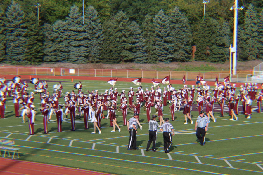 Coming through!  As the band plays, the freshman football players ran down the middle getting pumped up before the game. They went on to score 6 touchdowns that night.