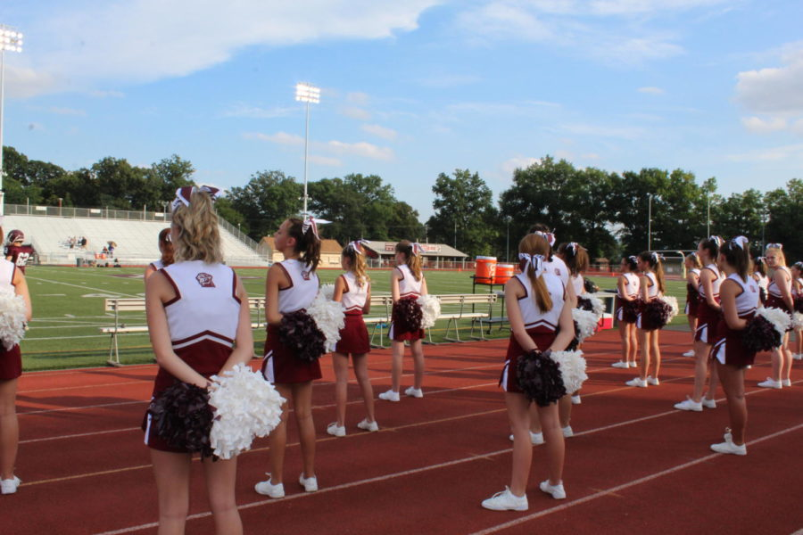 Ready Up! The cheerleaders observe the game as they wait for some action.