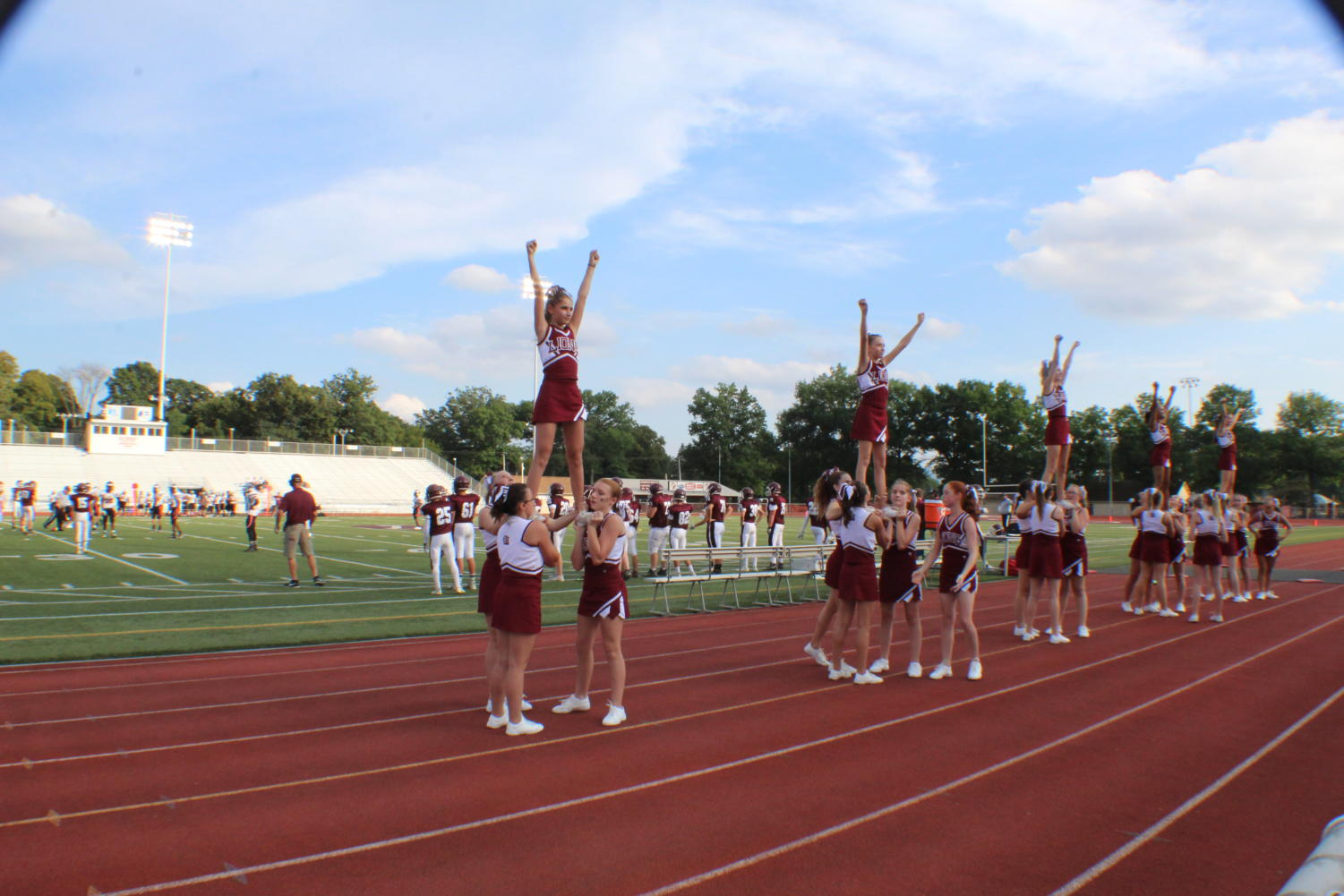 Fly High! The cheerleaders start off the game with some stunts.
