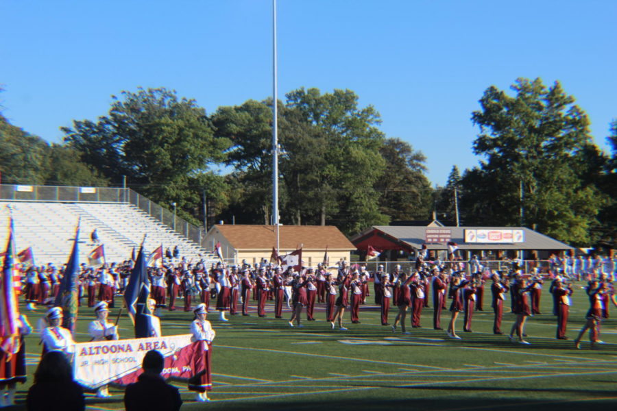 Line up! The members of the band form a path for the football players to run down as the band cheers them on. Oct. 18, was the last home game of the season and the football team finish with at score of 29-0 against State College