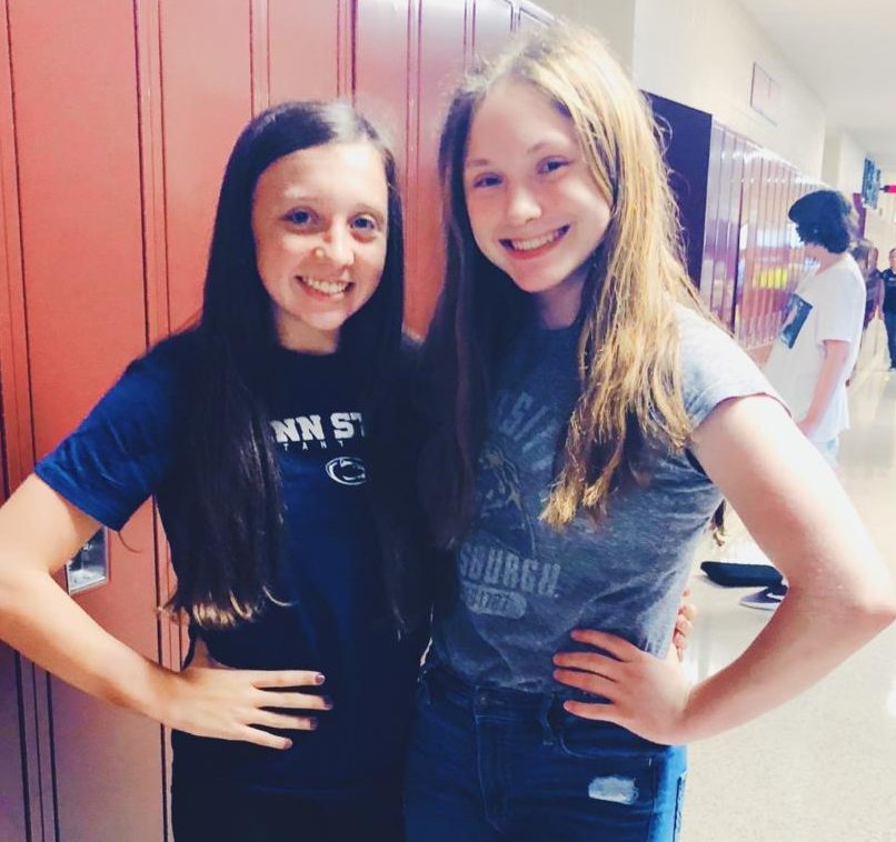 Rivals go head to head!  Gracie Weaver and Emma Girgany show their school spirit by wearing their favorite college sport team. College sport day was on Wednesday, Oct. 10.