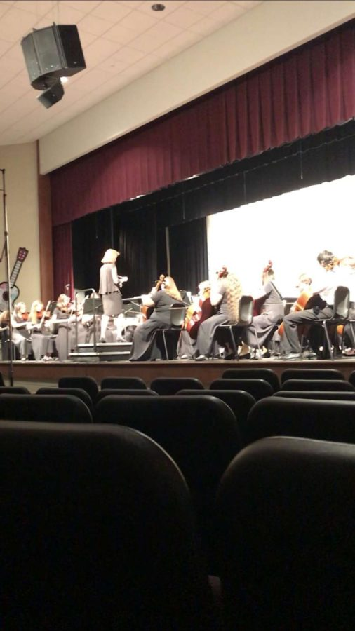 The orchestra which is combined with the wind instruments play their last song, Rudolph the Red Nosed Reindeer.  The concert finished with the symphonic orchestra to which they then called it a night.