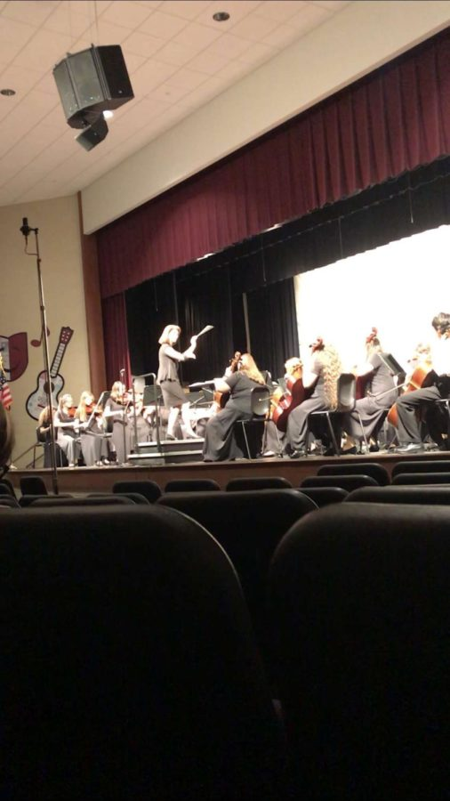 Kelly Detwiler instructed the orchestras.  Throughout the concert Detwiler didnt break a sweat.