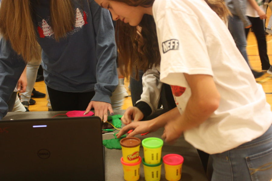 Feel the Play Doh! Ninth grader Emma Dietrick touches the Play Doh. She wanted to see what would happen next.