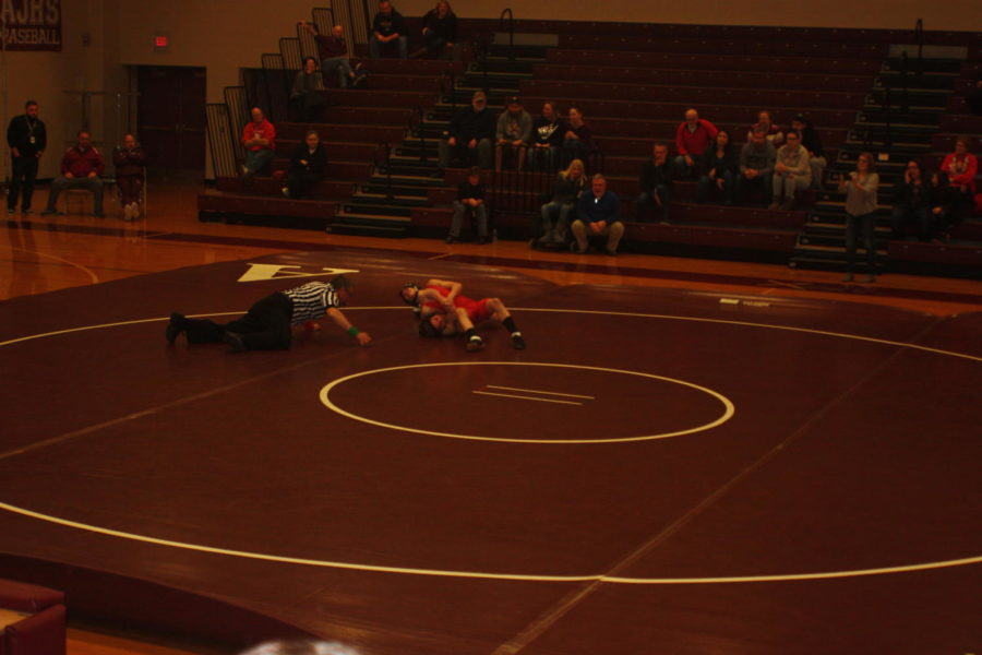 Watch close!  The ref gets down low and watchs to see if there is a pin.  Altoona faced Williamsport on Dec. 20.